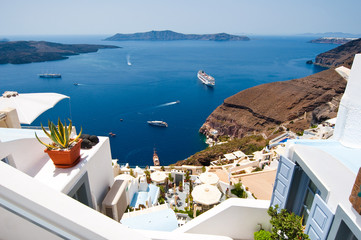 Fira town on the edge of the caldera on Santorini, Greece.