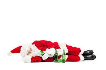 Drunk Santa Claus lying on the ground