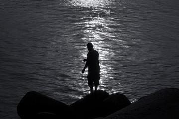 Lonely man fishing in the Kasimedu fishing  harbor, Chennai.