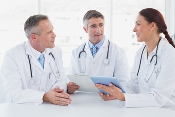 Doctors using a tablet together