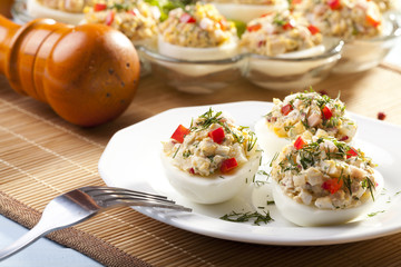 stuffed eggs with ham, red pepper and dill