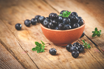 Blueberries in a bowl on a beautiful rustic table