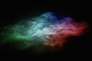 Wall Mural - Colourful powder exploding isolated on black