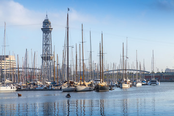 Port of Barcelona, Spain. Yachts, boats and old big tower