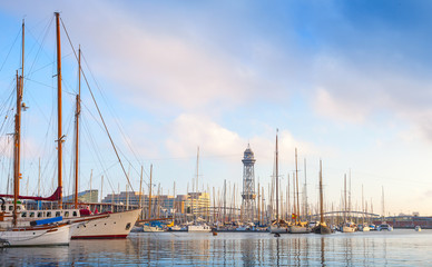 Sailing ships and yachts moored in Port of Barcelona, Spain