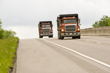 Two Dump Trucks on Highway