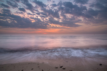 Baltic sea at beautiful sunrise on beach. big rocks in the water