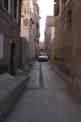 Narrow alley with car in Sanaa, Yemen