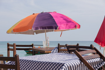 Beach Parasol and outdoor tables at a Restaurant