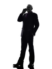 senior business man on the telephone smiling silhouette