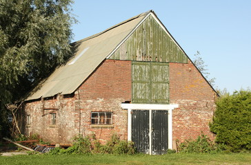Old barn in the countryside at Oostmahorn