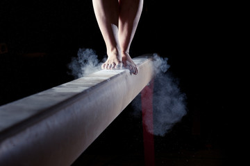 Poster Gymnastiek feet of gymnast on balance beam