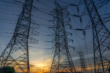 power transmission towers with sunset background