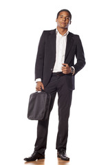 handsome African businessman standing on white background
