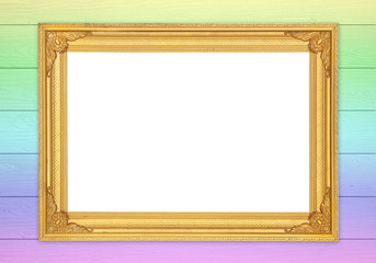 blank golden frame on colorful wood wall