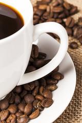Closeup two handle mug with coffee beans