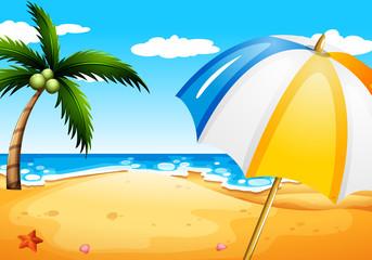 A beach with an umbrella