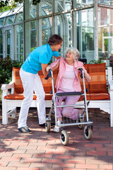 Senior lady with a care assistant or her daughter.
