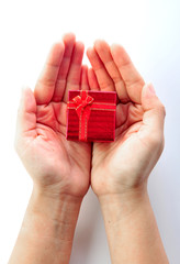 hands and gift over white background