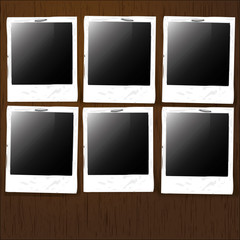 Empty Photos Stapled on Wooden Background