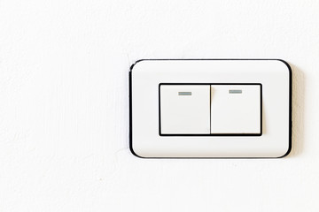 Double Lightswitch on White Wall On and Off