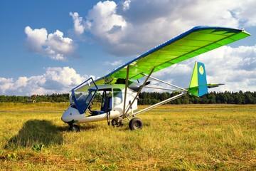 Ultralight weight plane on a grass field