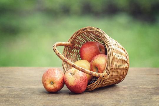 apples in wicker basket on table