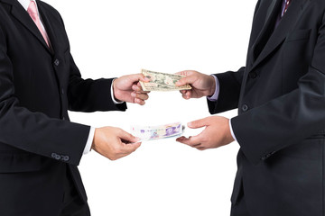 Businessmen exchange banknote dollar and yuan