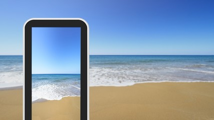 Tablet, smartphone taking picture of sandy seashore