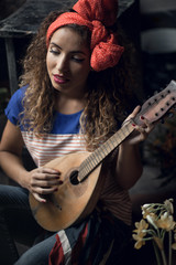 Young girl with a guitar.