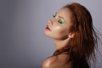 Imagination. Redhead Woman with Wet Hair Dreaming