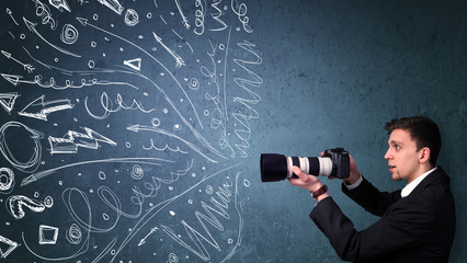 Photographer shooting images while energetic hand drawn lines an