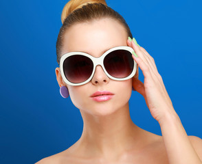 Portrait of young beautiful woman in sunglasses
