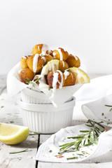 balls of fried potatoes with dripping yogurt sauce