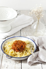 handmade pasta with ragout sauce on vintage plate