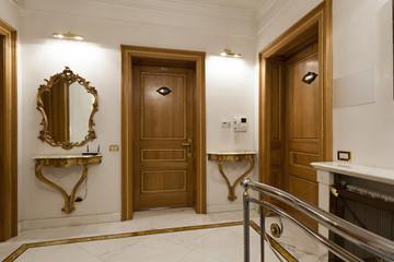 Two wooden doors in hotel corridor