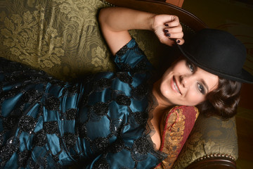 Beautiful woman lying on sofa, baroque style