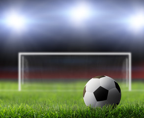 Soccer ball on green stadium.