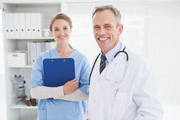 Smiling doctor looking at the camera