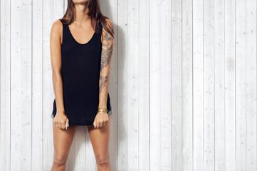 Young woman wearing black sleeveless t-shirt