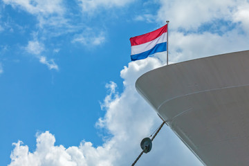Anchored cruise boat with a Dutch Flag