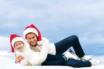 beautiful mother and her daughter hugging at Christmas