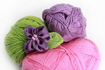 knitting accessories - three skeins on white background