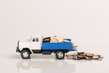 toy truck with coins