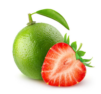 Isolated fruits. Fresh lime and cut strawberry over white background, with clipping path
