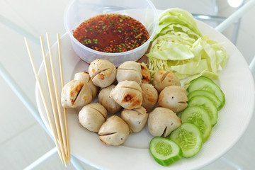 Meat ball with vegetables and sauce