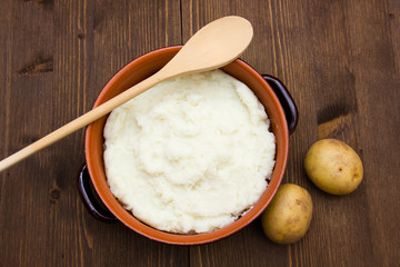 Mashed potato with spoon seen from above