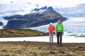 Adventure hiking travel couple trekking on Iceland Wall mural