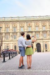 Tourists taking photo of Stockholm Royal Palace