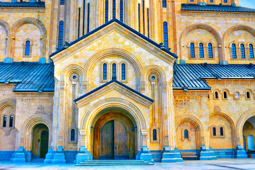 Wall Mural - The Holy Trinity Cathedral Tsminda Sameba in Tbilisi at sunset,